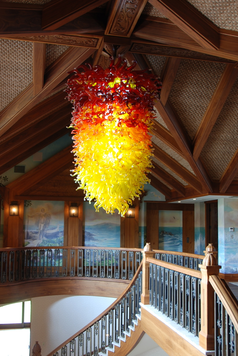 Pele Chandelier of over 1000 hand made pieces of glass and illuminated with LEDs.   by artist         Rick Strini withStrini Art Glass