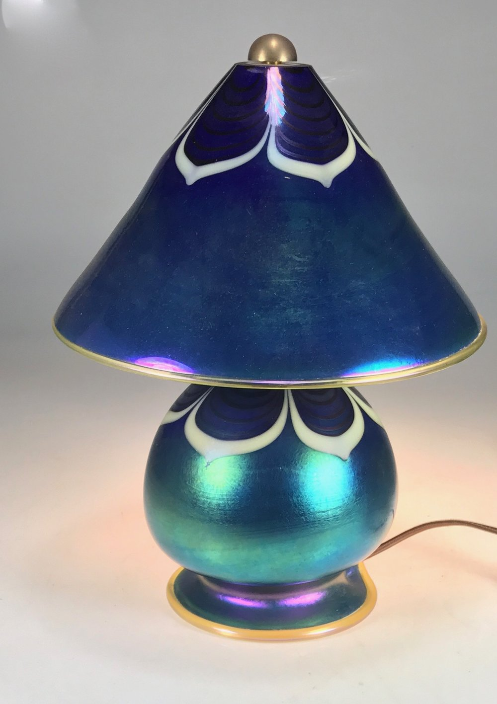 Blue Luster Gem Lamp with hand decorated pulled lines   available now  strini art glass .