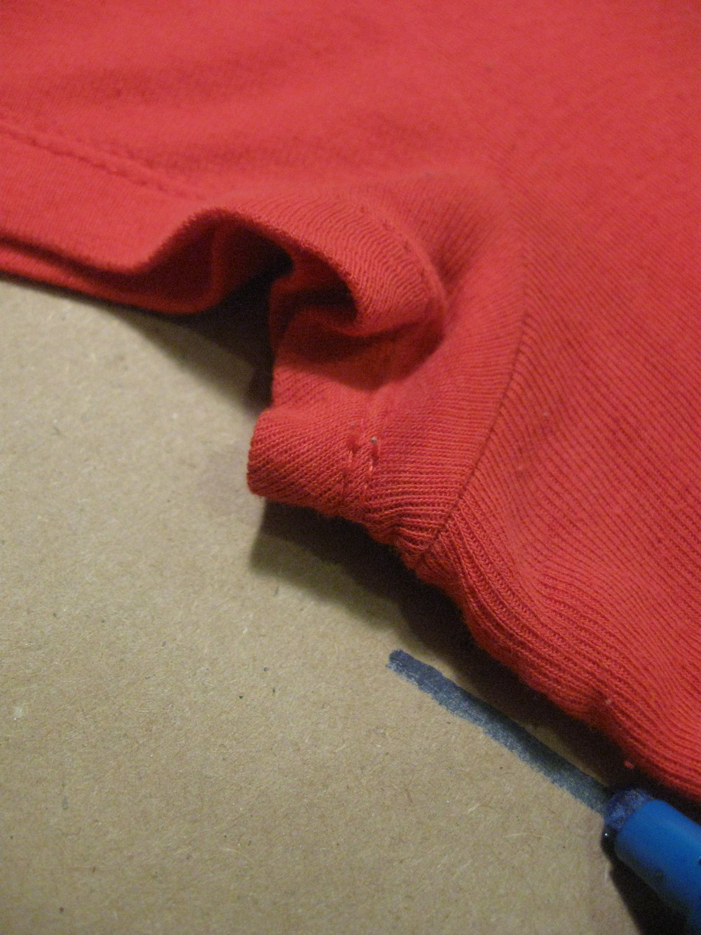 Down one side of the shirt. Begin tracing at the seam line where the sleeve and body are sewn together, as shown.