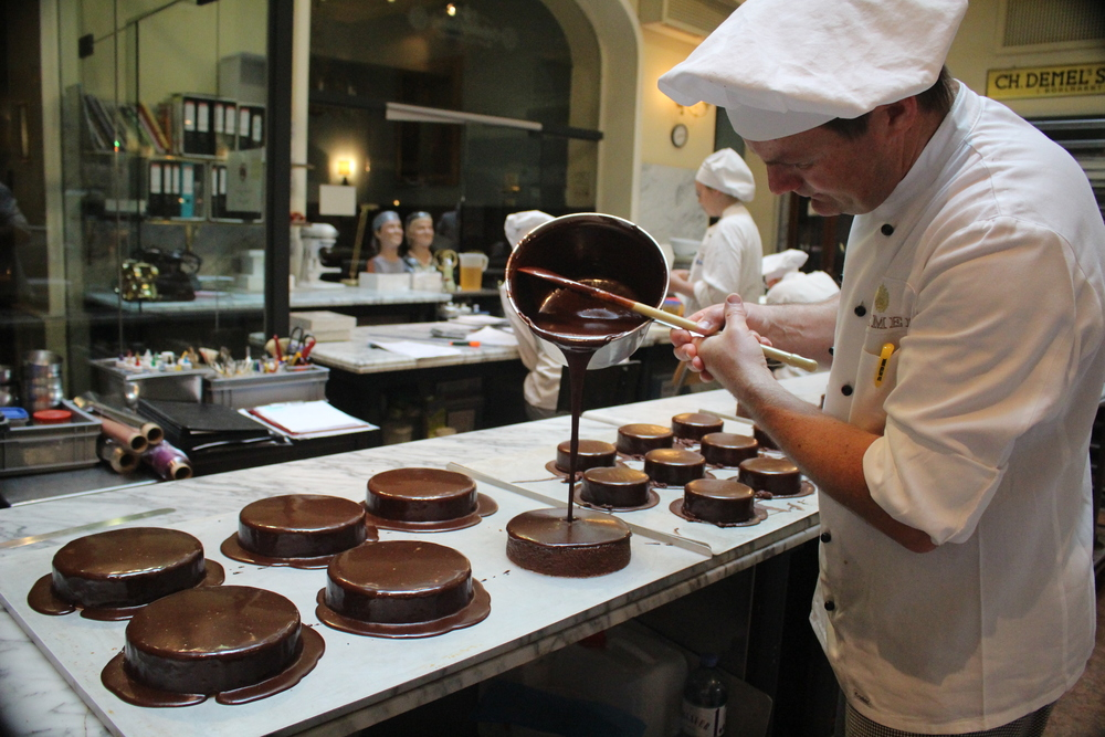 Glazing Sachertortes at Demel (photo: Anne Banas)