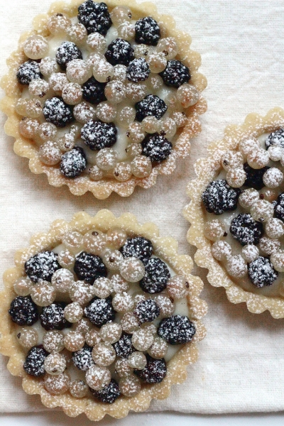 Three white currant-blackberry tarts