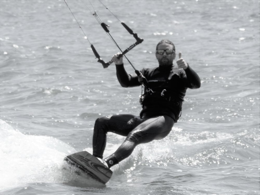 """One of Tim's Favorite ways to enjoy our Great Lakes State is kiteboarding. If you see him out there make sure to come say, """"Hi""""!"""