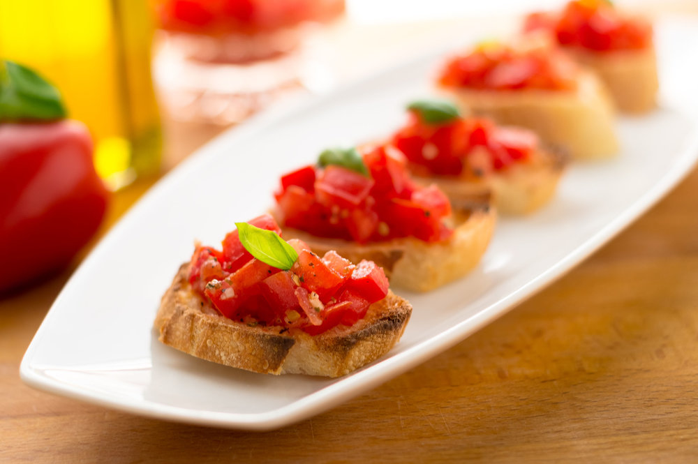 Plate of Bruschetta. Italian tomato bruschetta served as appetizer, made with fresh ingredients like tomatoes, garlic, basil, bread and olive oil..jpg