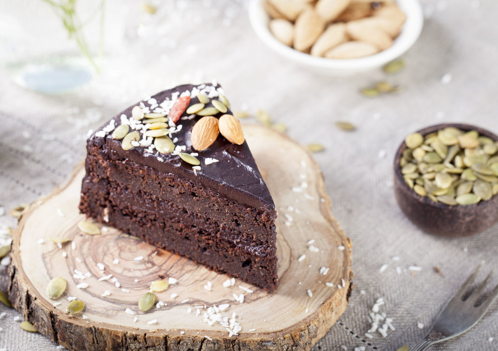 Vegan chocolate beet cake with avocado frosting, decorated with nuts and seeds.jpg