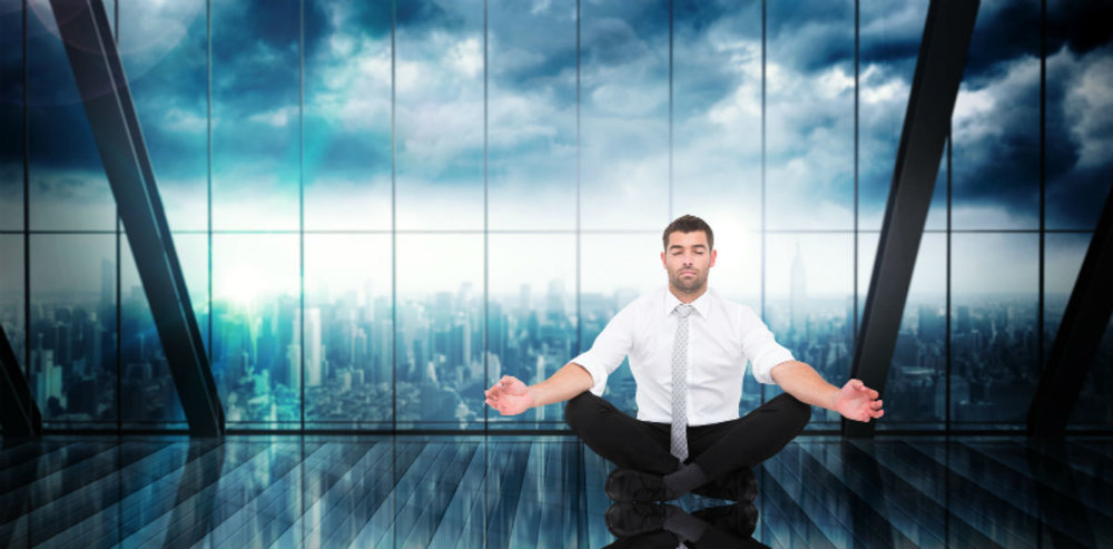 Businessman-meditating-in-corporate.jpg
