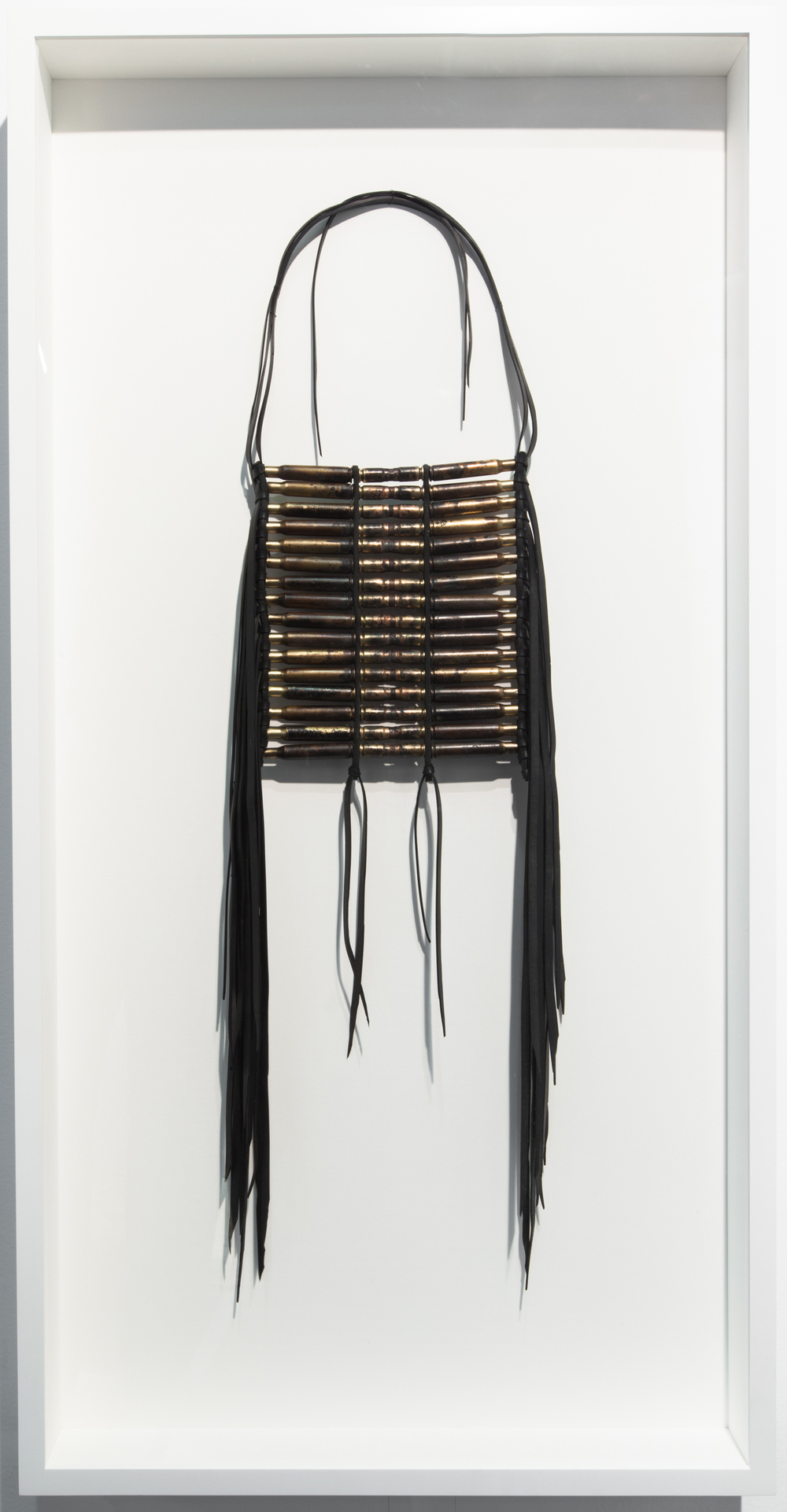 Dave Cole-Breastplate No.8  (after Caddo artifact, date unknown, from a photograph dated 1898)-2013-Military Surplus Gasketing, Butyl Rubber, Military Cartridges, Recovered Projectiles-41x21x3.75-framed.jpg