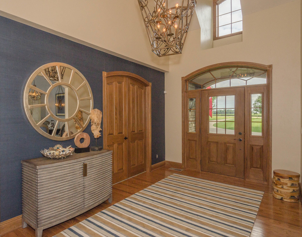 FOYER WITH BLUE AND NEUTRAL PALETTE