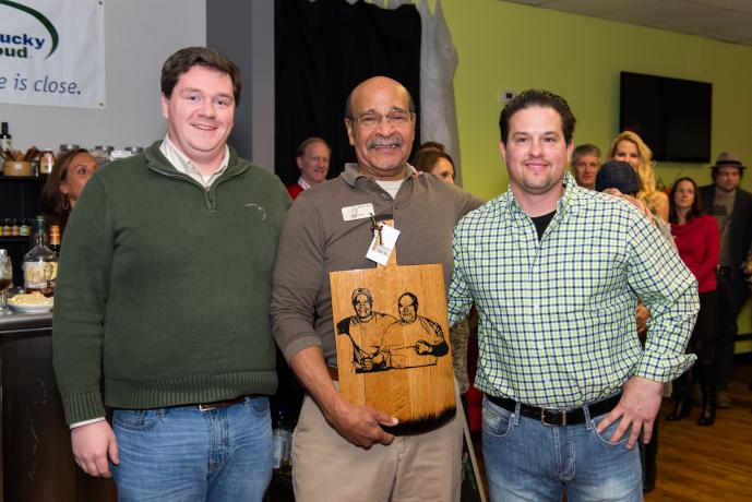 Tony Davis and Matt Higgins presenting Buffalo Trace's Freddie Johnson a custom-made Kentucky Bourbon Barrel cutting board, honoring Freddie's late father.