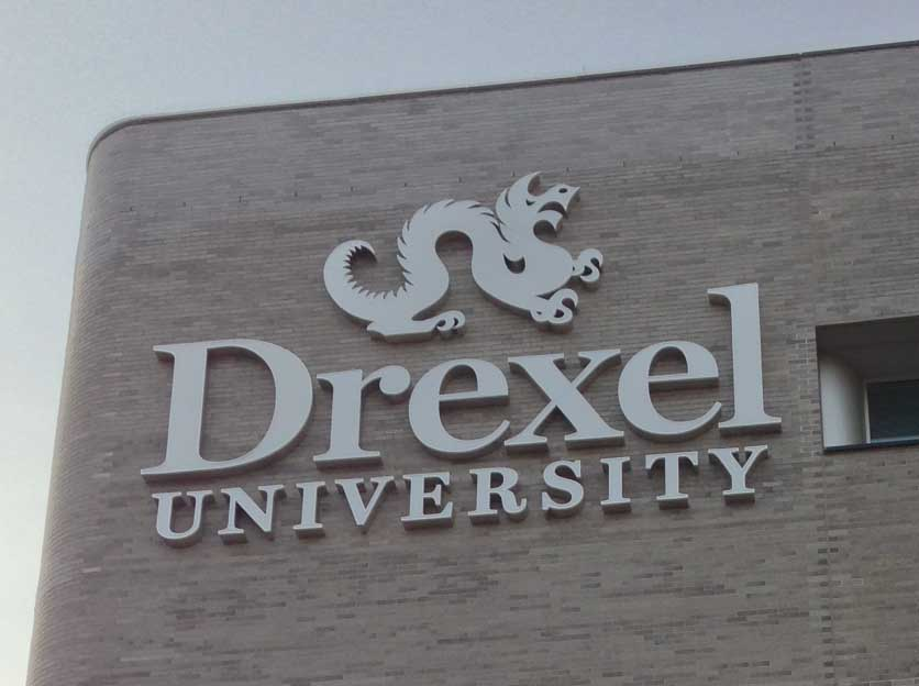 "Drexel University, One Drexel Plaza, Philadelphia PA    Olaya Studio has worked with Drexel University on various projects at One Drexel Plaza.  Some of these include the renovation of the lobby, the design and installation of the exterior sign and interior design and architecture for the Drexel e-Learning offices.      We designed and coordinated the installation of three groups of signs on the eastern exterior facade.  The first sign arranged the ""3001"" vertically near the south-east corner of the building. The second sign proposed the back-lit letters for ""One Drexel Plaza"" along the east facade near the building's entrance. The third sign proposed as a back-lit combination of ""Drexel University"" with the dragon logo located in the top east corner of the building's facade."