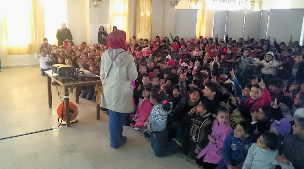Children take part in a discussion after educational screening, March 2015