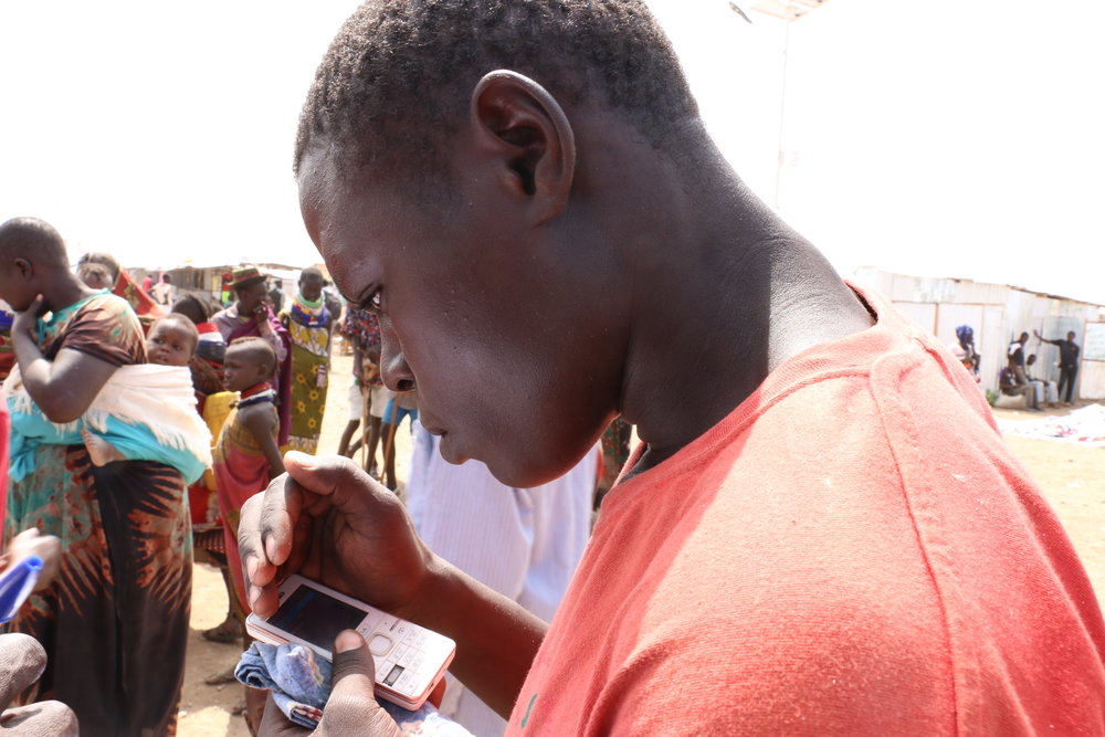 FilmAid conducting registrations for its Bulk SMS Messaging Service for Refugees in Kakuma.