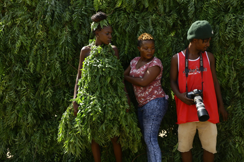 Mercy Akout (left), Amina Rwimo and Abdul Patient behind the scenes during the making of the 'Sukar' Music Video