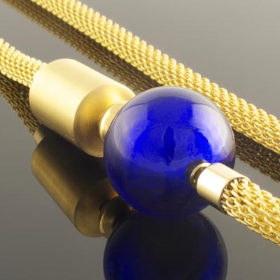 Blue murano glass clasp on woven gold necklace