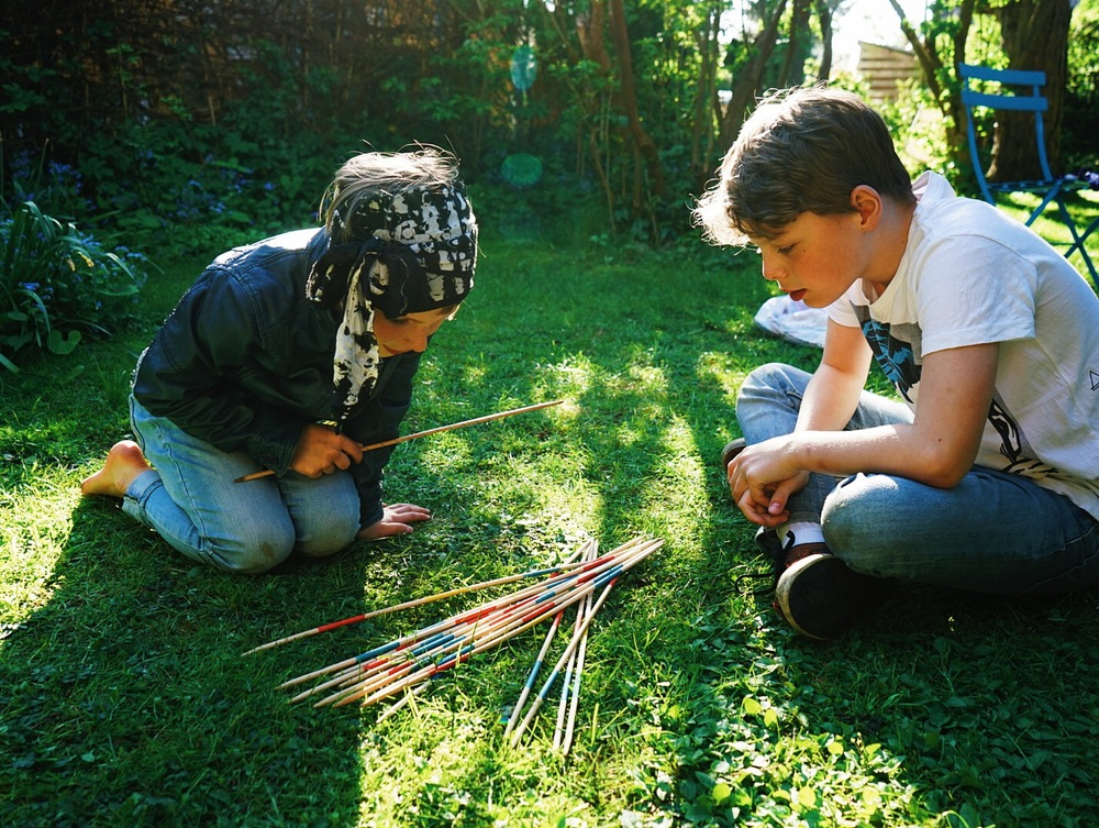 Playing Mikado in the garden.