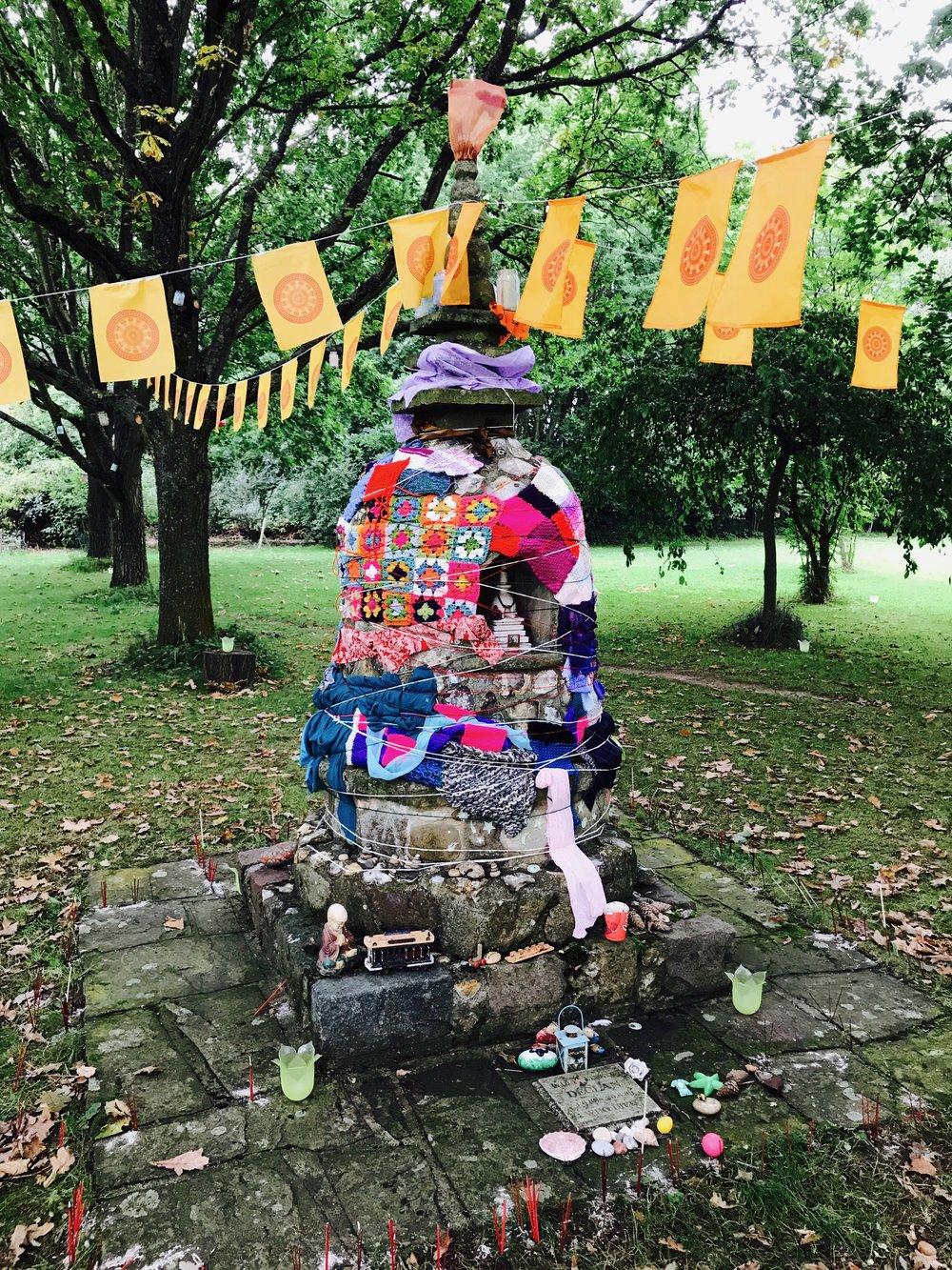 'yarn bombing' the Stupa in the Buddha Grove, Family Camp 2017