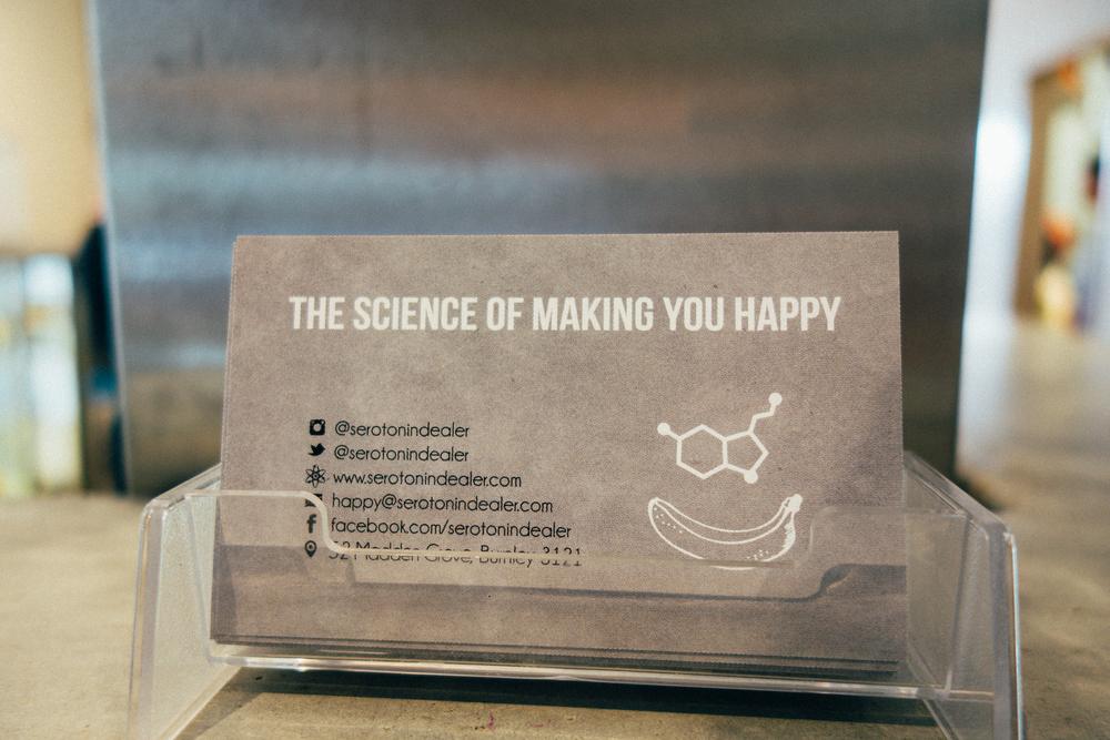 serotonin eatery business card