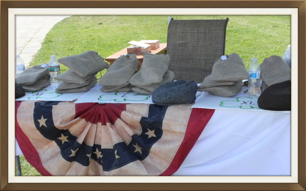 Under a tent on the 18th hole we provided gray and brown herringbone caps with burlap cargo bags.