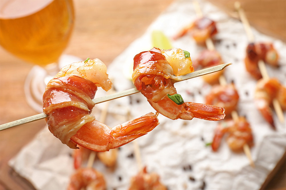 Rock and roll prawns - Bacon roll with prawns.