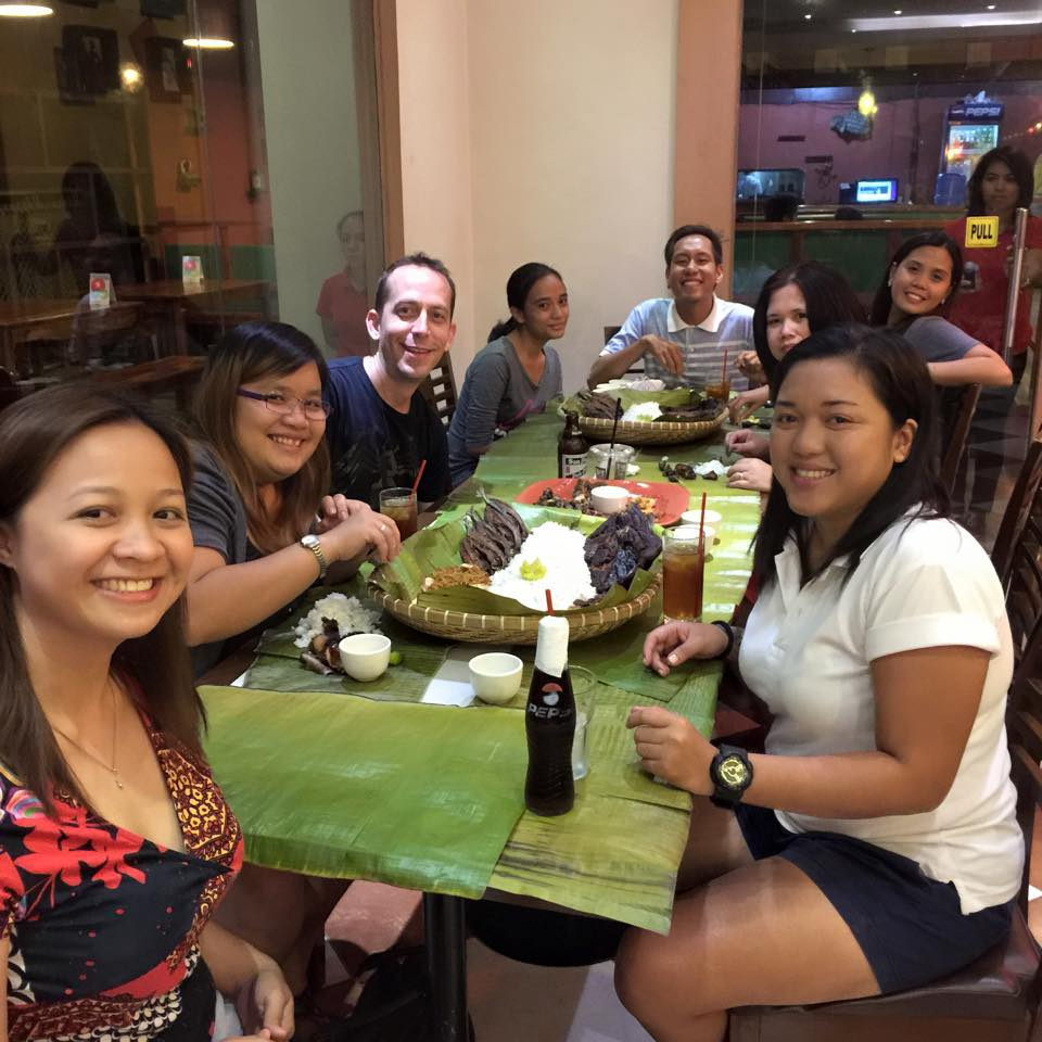 Team Rocket with Chris enjoying their boodle fight dinner at Captain Ribbers.