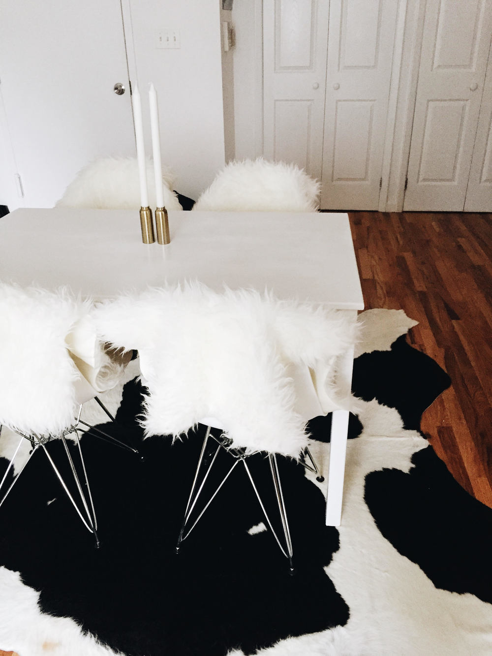 arushi khosla, arushi.co, williamsburg, home decor, cowhide rug, minimalist decor, cb2, west elm, shag rugs, all white decor
