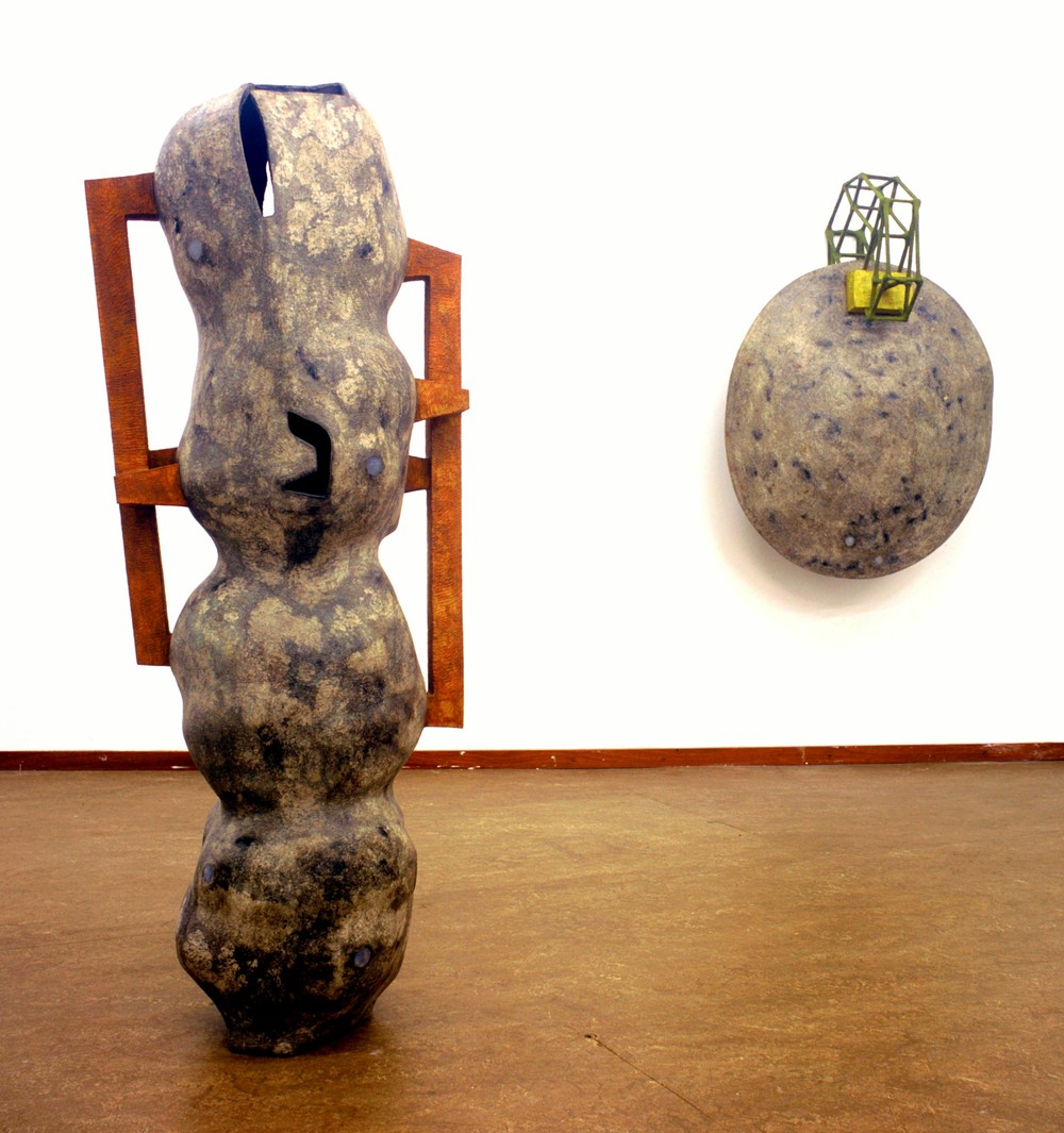 left: Untitled 2004 - 2005 , Newspaper, leaflets, inorganic household waste, ashes, wax. 133 x 52 x 39 cm. right: Idem. 118 x 83 x 45 cm. right: Private collection. Photo: W.Vermaase.