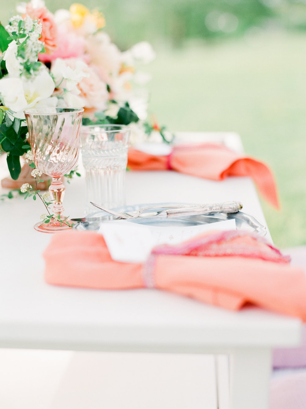 Blush goblet and a linen napkin in a juicy color brings the floral color to the neutral place settings.   Paper goods by  Designs In Paper . Styling by Feather + Oak. Photo by  Julie Paisley .   Florals by  Petal and Pine .