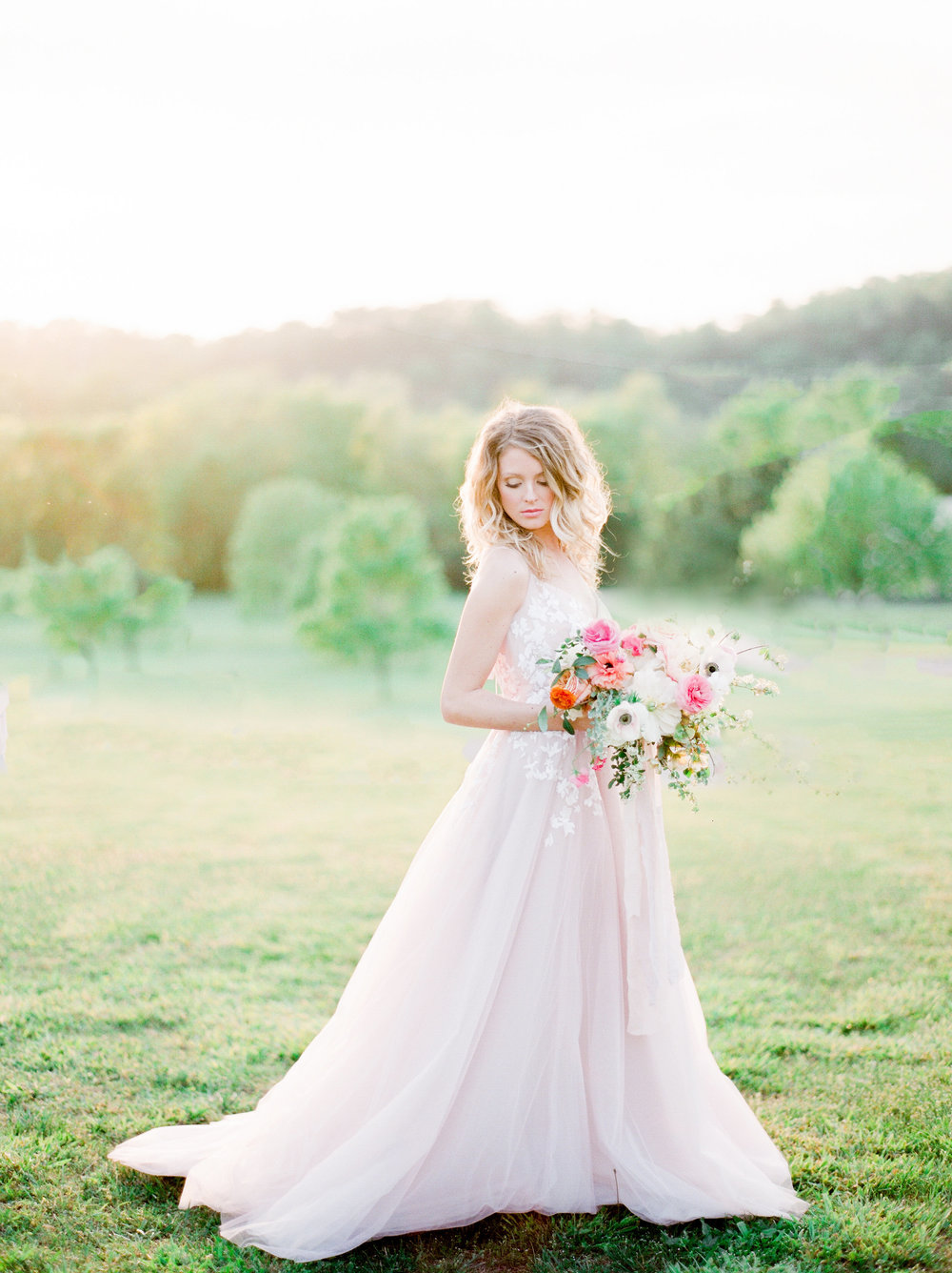You can be a bride and wear color. Rosy gown by Hayley Paige. Photo by Julie Paisley. Florals by Petal and Pine. Styling by Feather + Oak. Hair and makeup by Leslie Ellis.