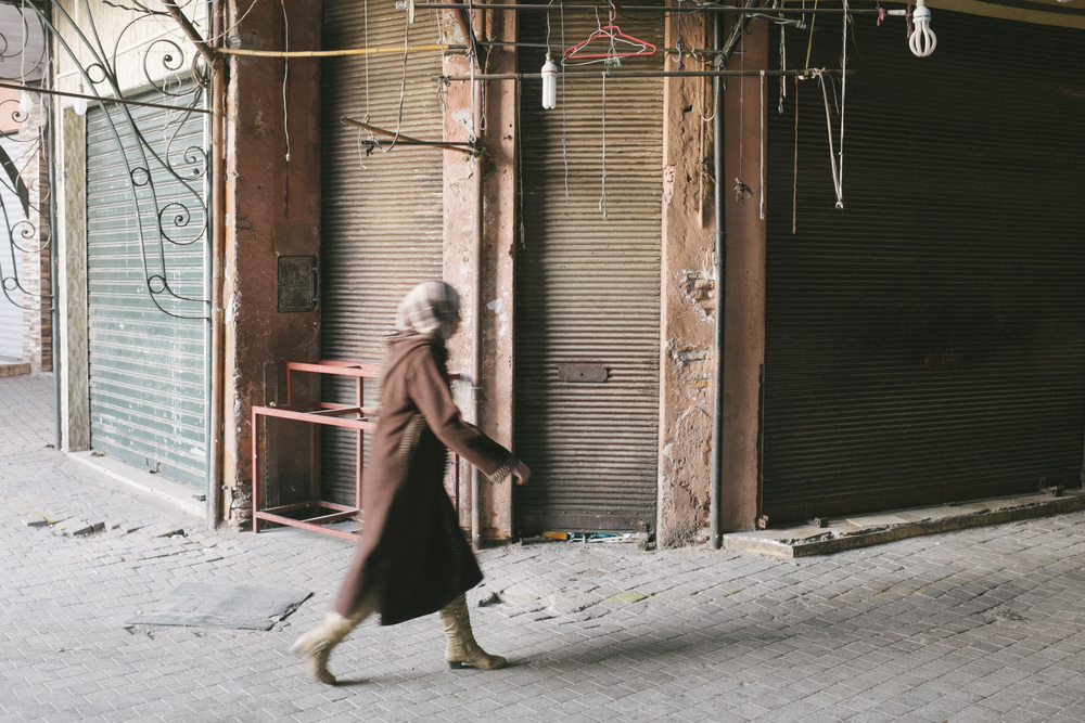 Lady walks through the Souks, Marrakech