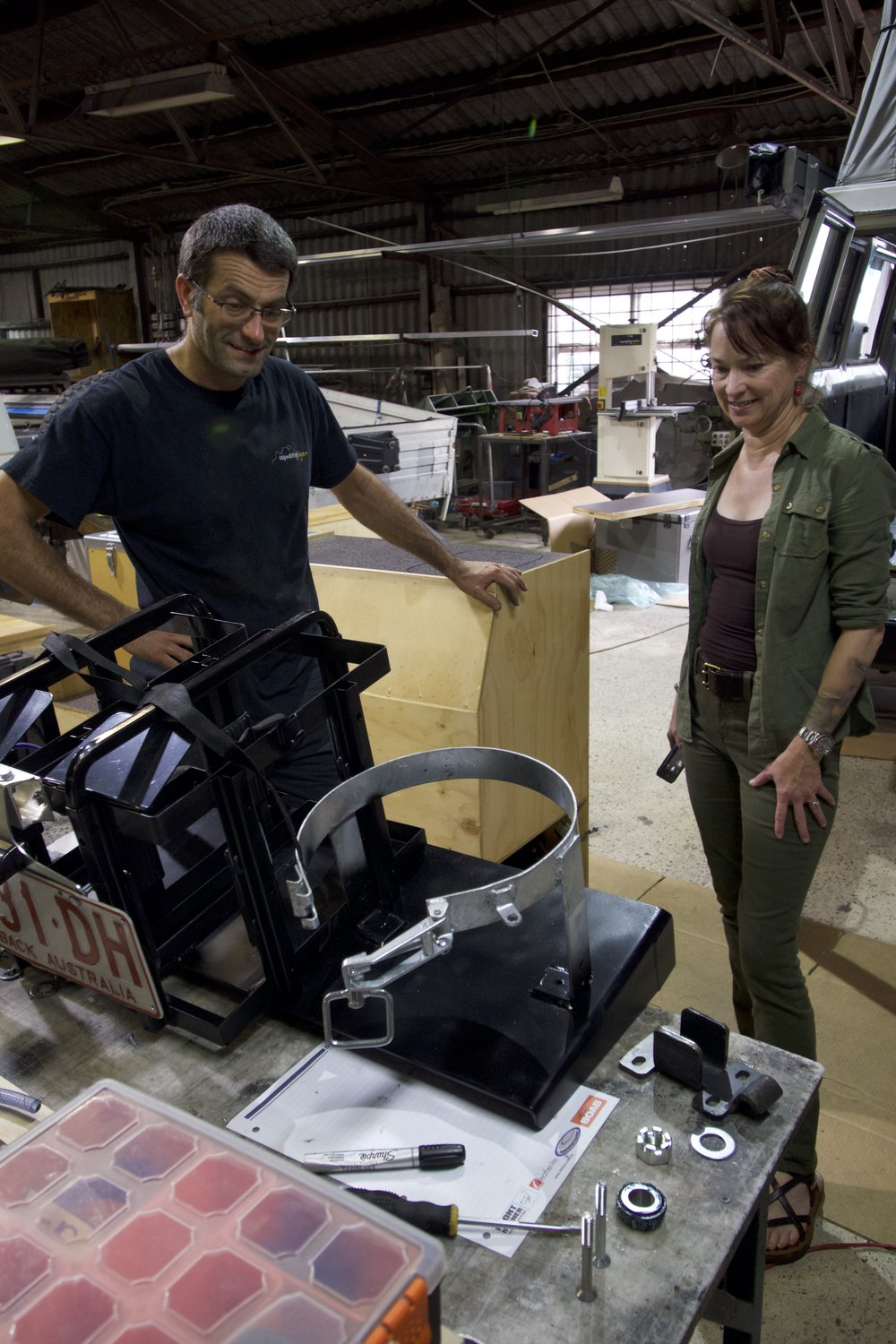 Daniel and Roseann inspect the jerry can/gas bottle holder for the Kaymar.
