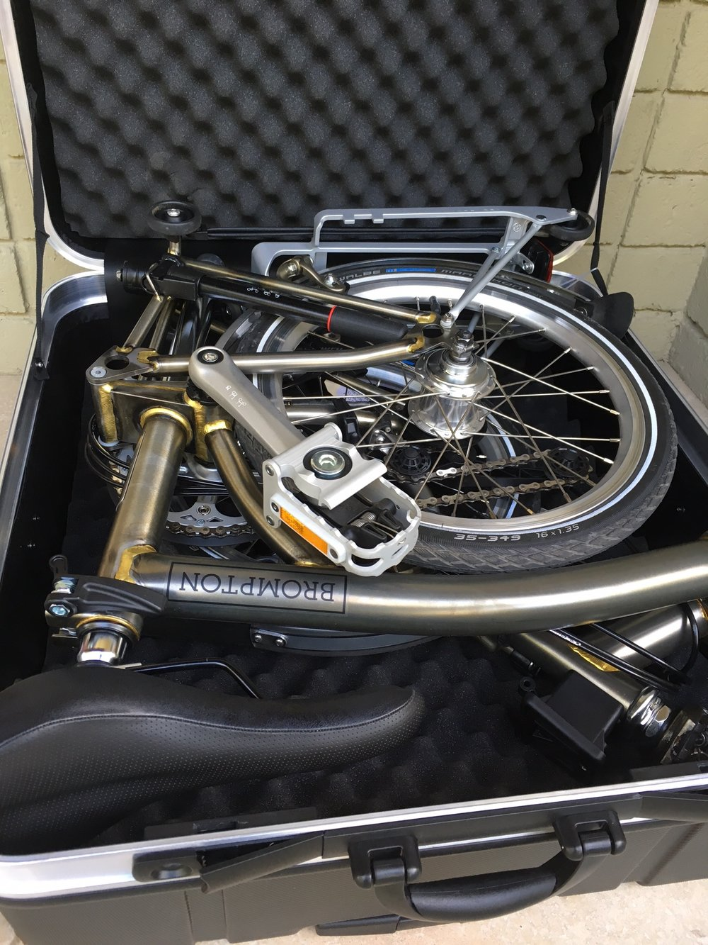 Among many aftermarket options is this excellent, wheeled hard case.