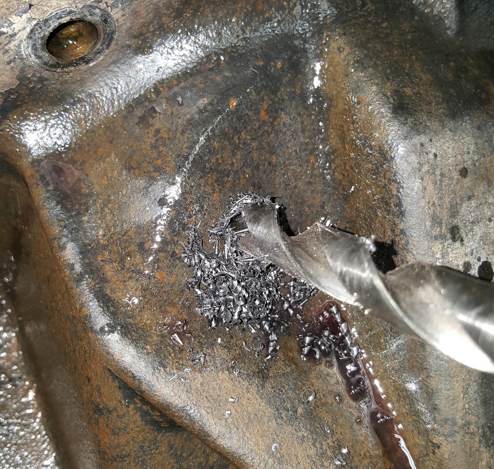 The fun part: drilling a hole in a perfectly good differential housing.
