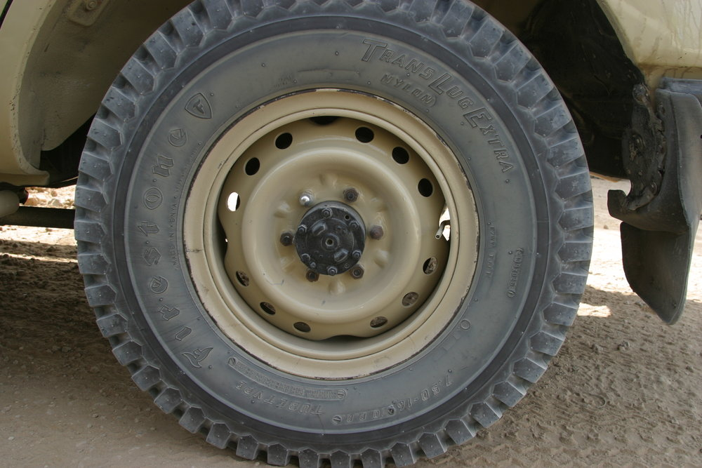 African Firestone tire on a split rim.