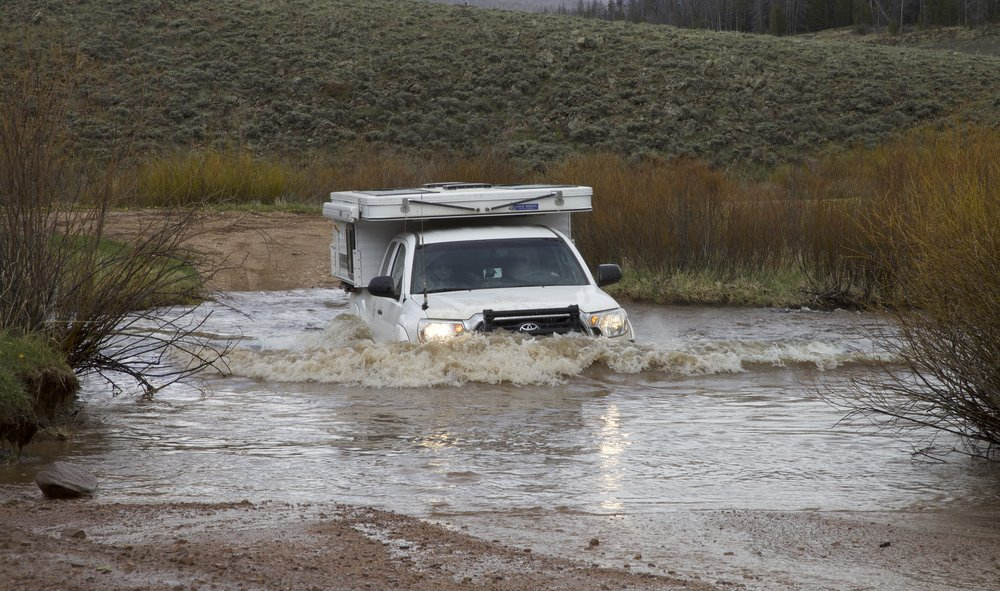 Not too fast, not too slow: This vehicle is pushing a proper bow wave through this stream crossing.