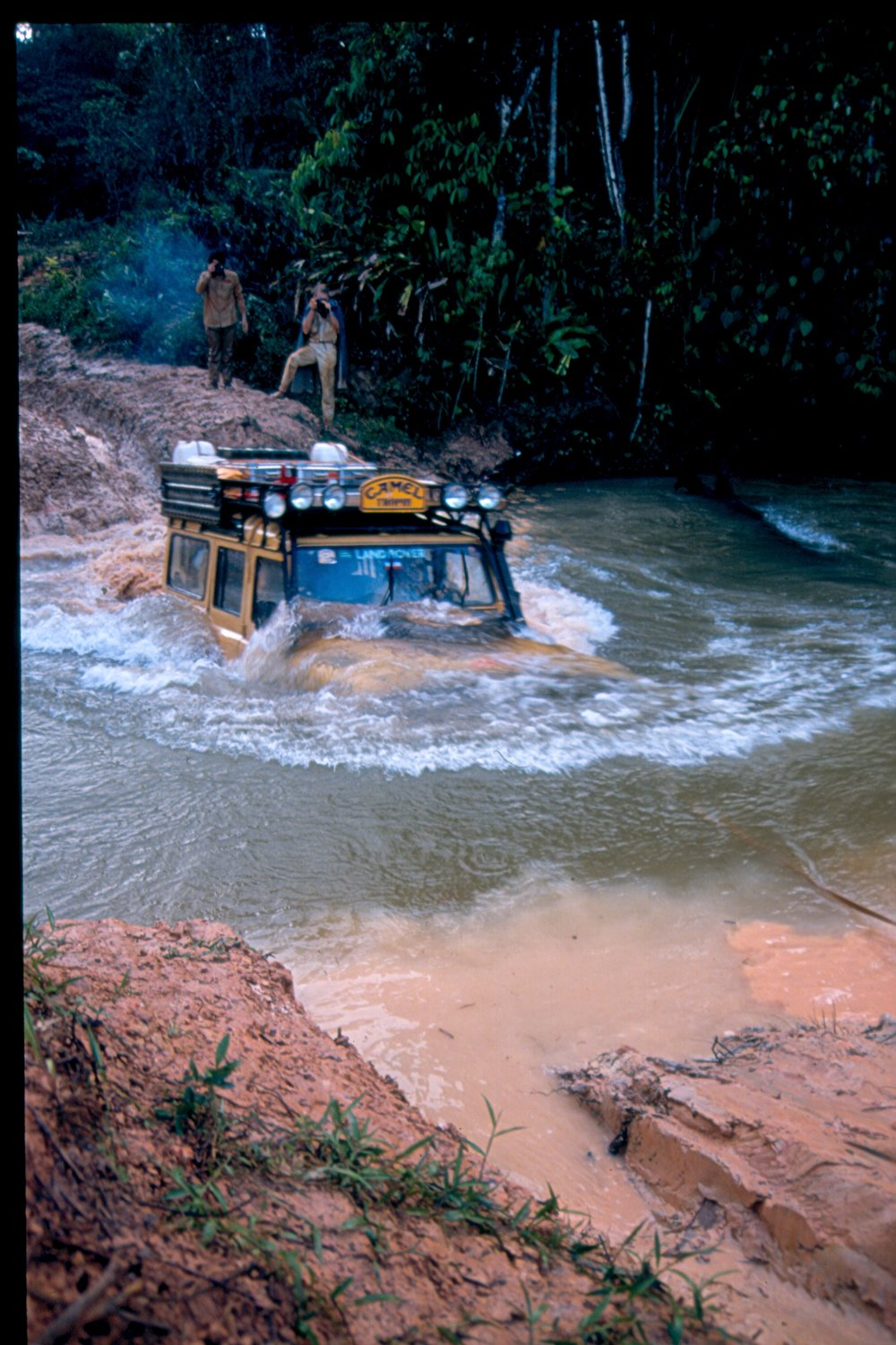 With non-electronically controlled turbodiesel engines and well-sealed snorkels, vehicles such as this Camel Trophy Land Rover 110 are capable of fording very deep water indeed. Courtesy Pete Sweetser/Camel Trophy Owners' Club