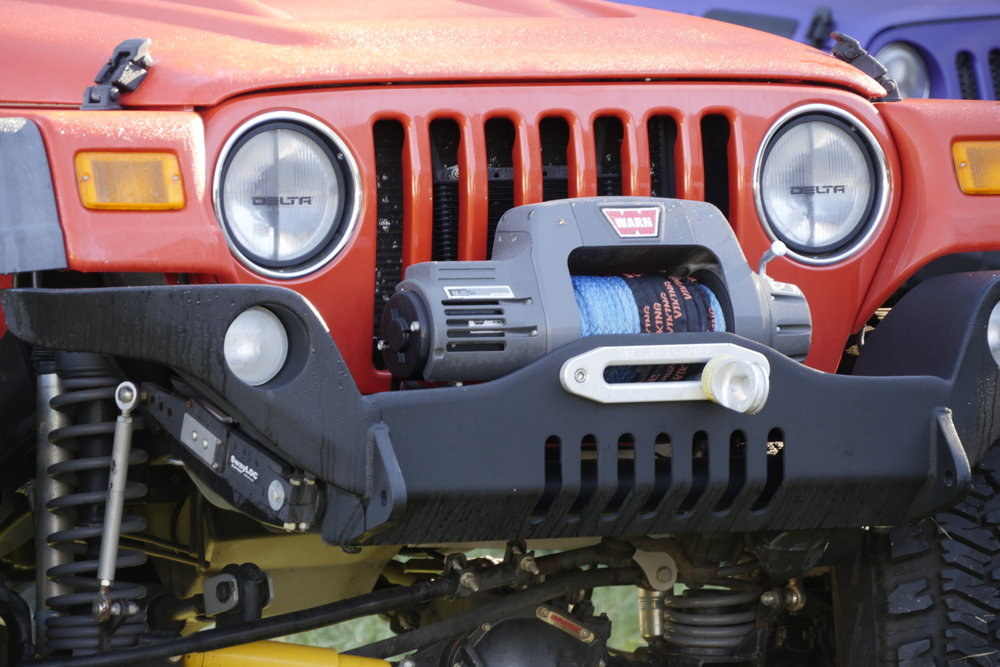 "Many overlanders would scoff at this ""rock-crawling"" bumper on a Wrangler—but access to the winch is excellent. (However, as long as we're here, I don't like the shallow radius on that hawse fairlead.)"
