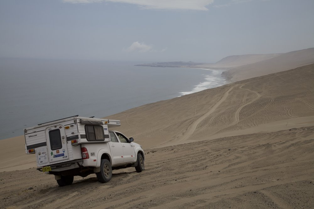 Negotiating a loose, sandy side slope in Peru above the Pacific. Even a relatively lightweight camper raises the center of gravity significantly.