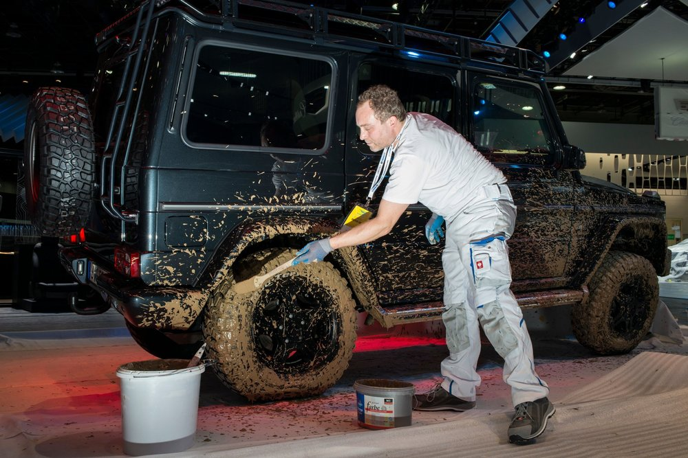Nope: This is a car show. He's  adding  mud . . .