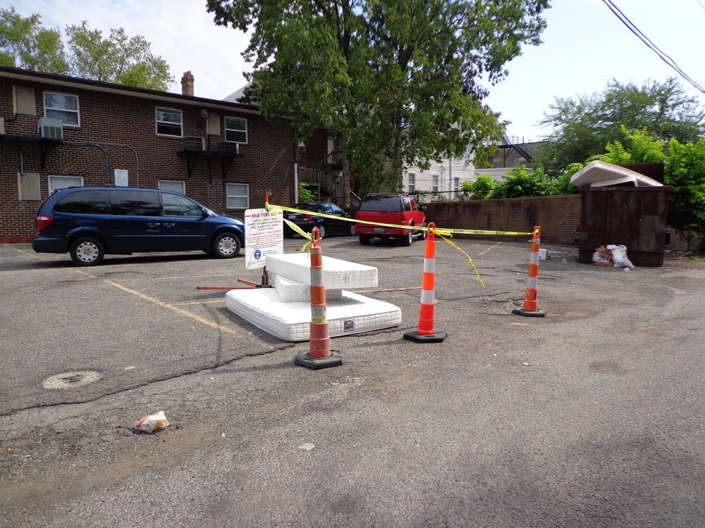 Coned parking spaces in parking areas with City of Columbus sign