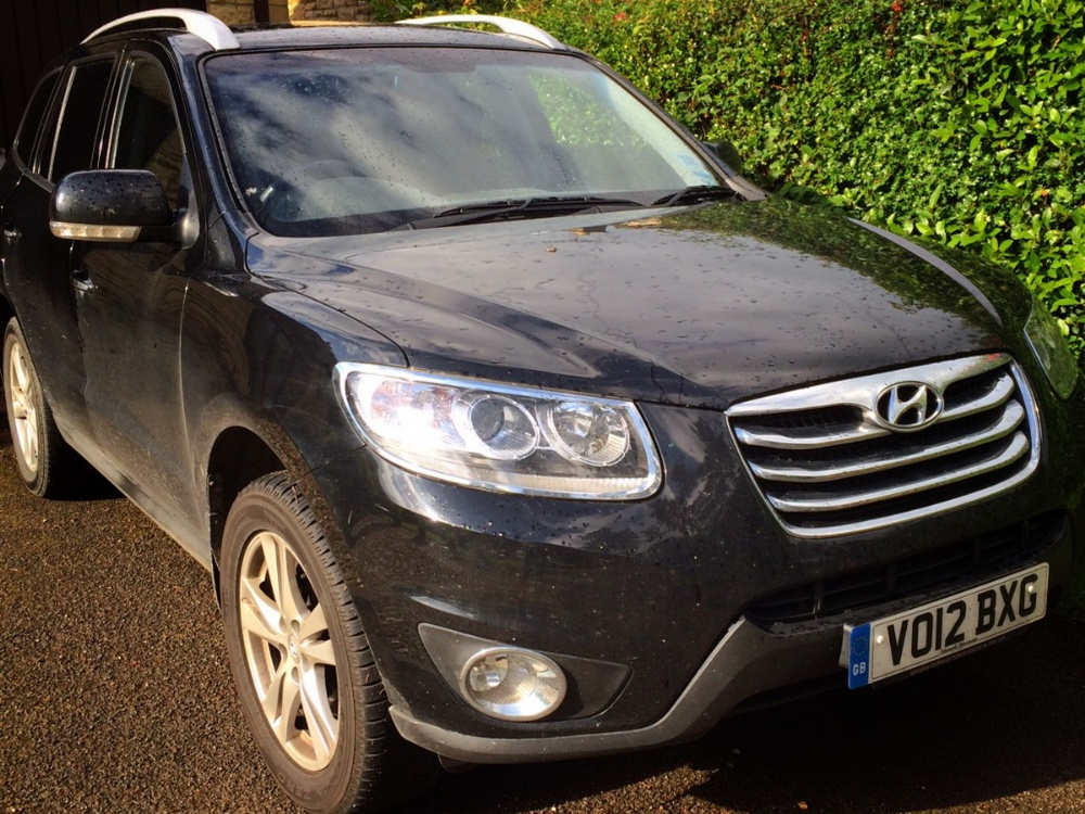 The Mighty Chariot - a Hyundai Santa Fe Premium Automatic, in knackered black