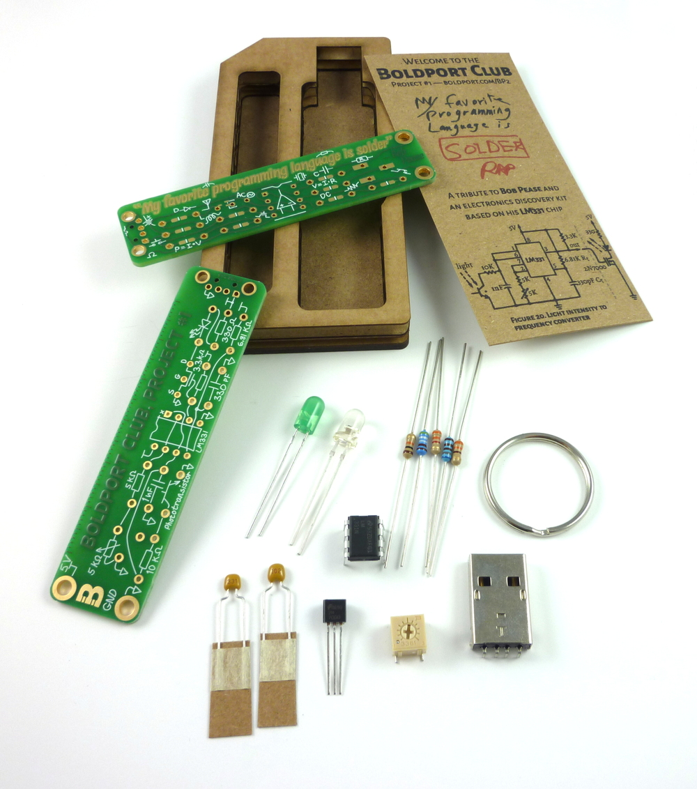 The contents of the kit. Each kit comes with two instances of the PCB.