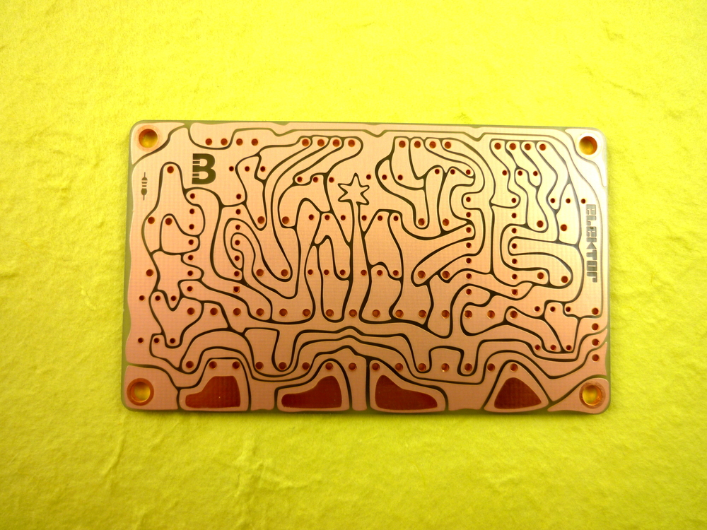 The first board with the solder polarity symbol