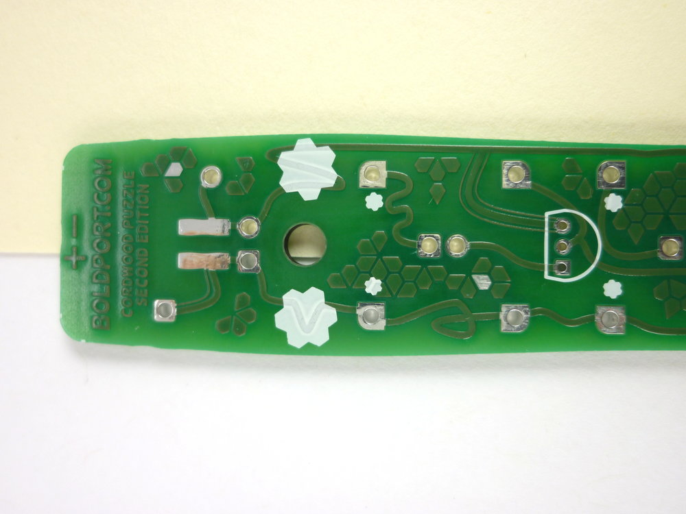 The two circuit boards are identical, but function differently depending  on how they are wired. You can mark one of them on the white silkscreen  patches with a pen to distinguish between them if you like.