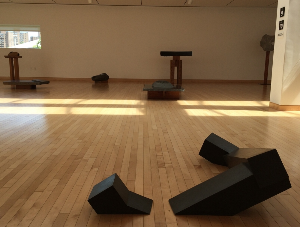 Foreground:  Floor Frame , Isamu Noguchi. 1962. Bronze.