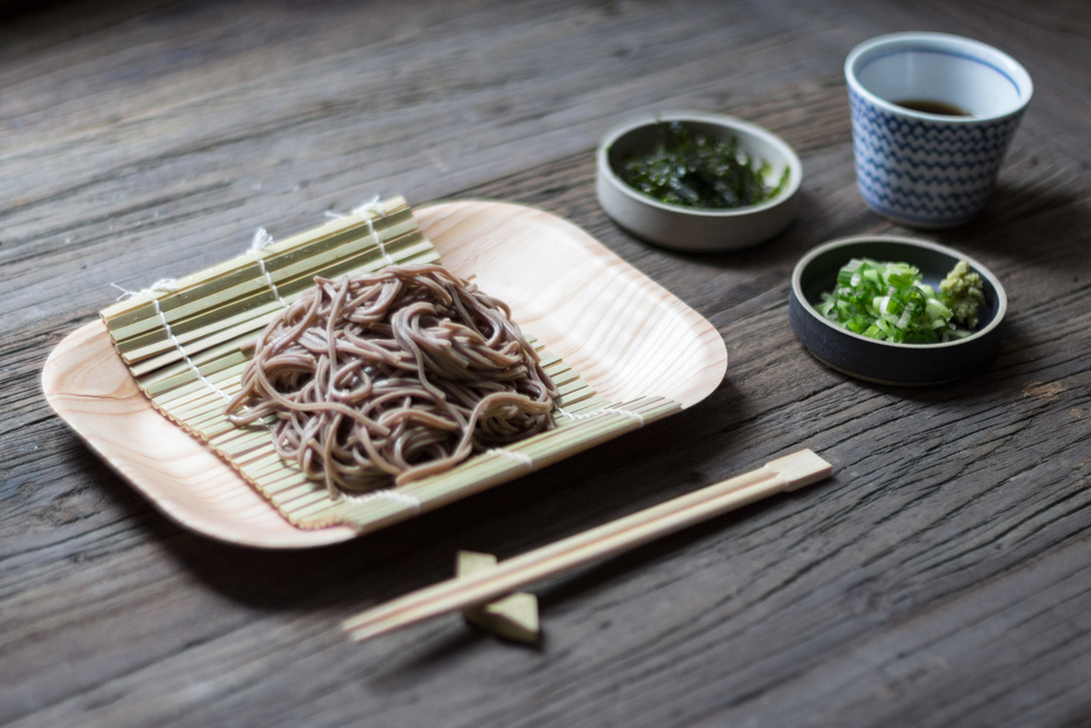 Soba is traditionally served on bamboo mats. We're using the futagami brass chopsticks rest with tobe - yaki and hasami bowls.