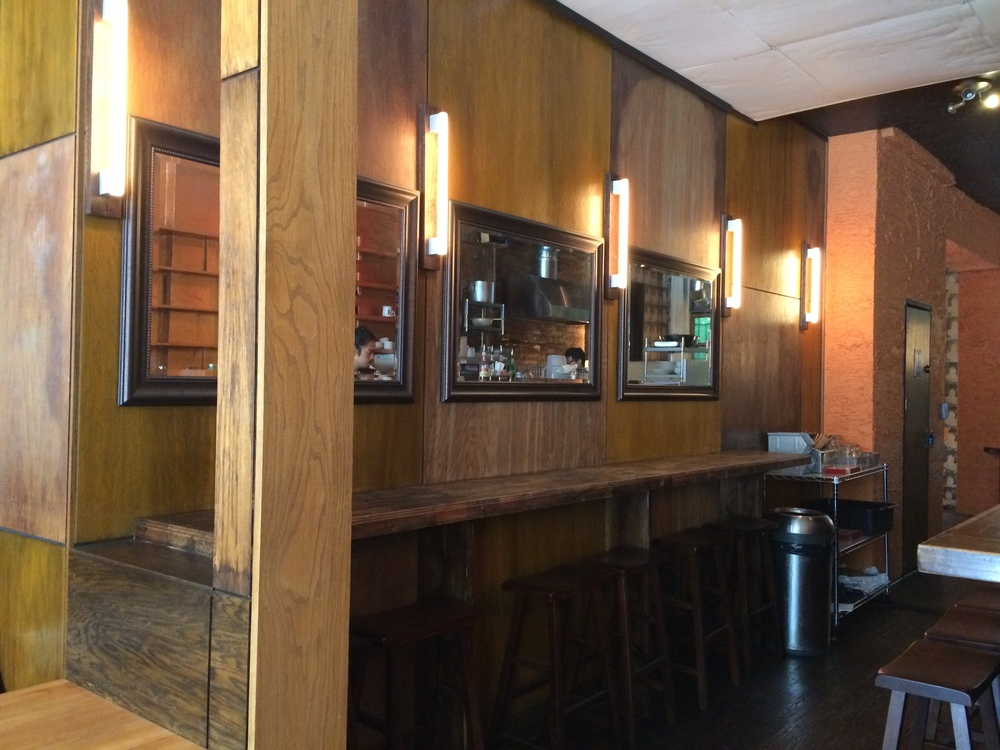 Catswall's interior is cozy and minimal with warm wood paneling.