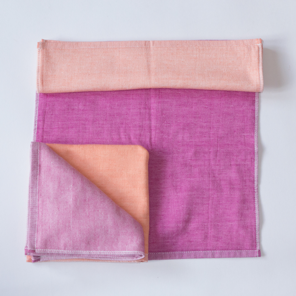 The Yoshii two-tone chambray towel in Pink 1, Pink 2, Orange 1 and Orange 2.