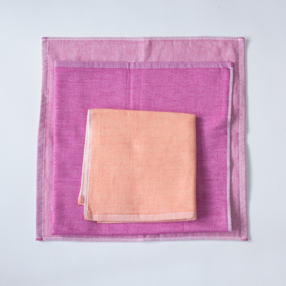 Our Yoshii Two-Tone Chambray towel in Pink 1, Pink 2 and Orange.