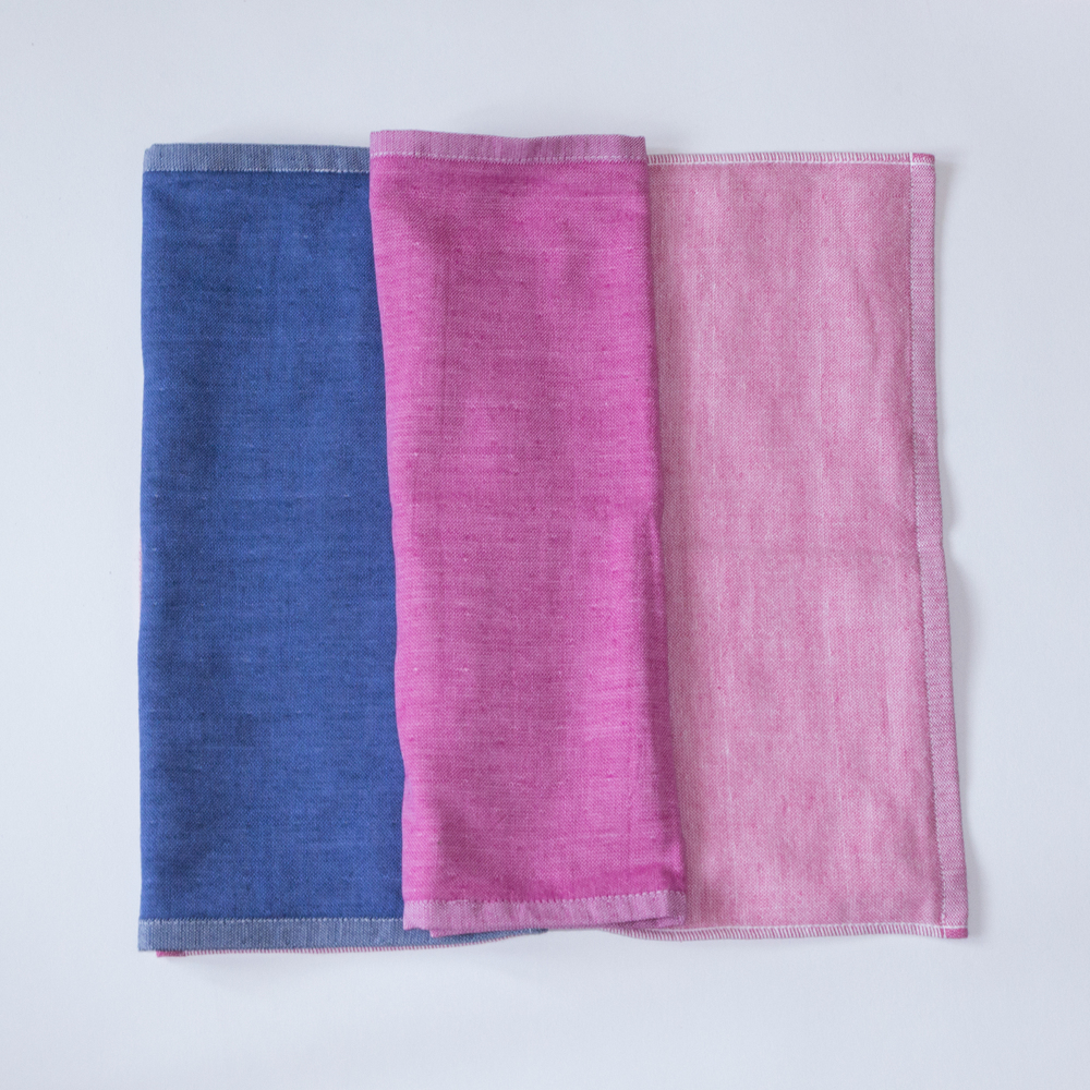 The Yoshii two-tone chambray towel in Blue 2, Pink 1,  and Pink 2.