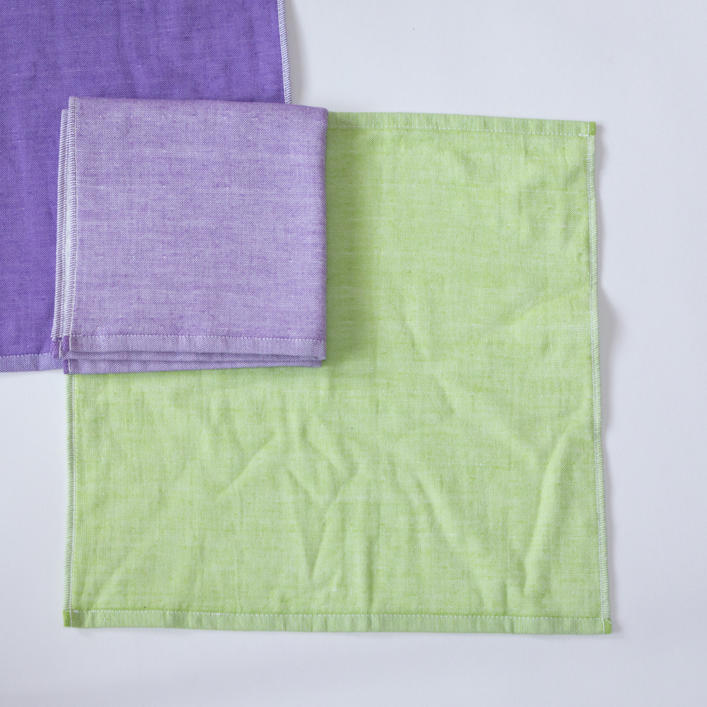 Our Yoshii two-tone chambray towel in Violet 1, Violet 2 and Green 2.