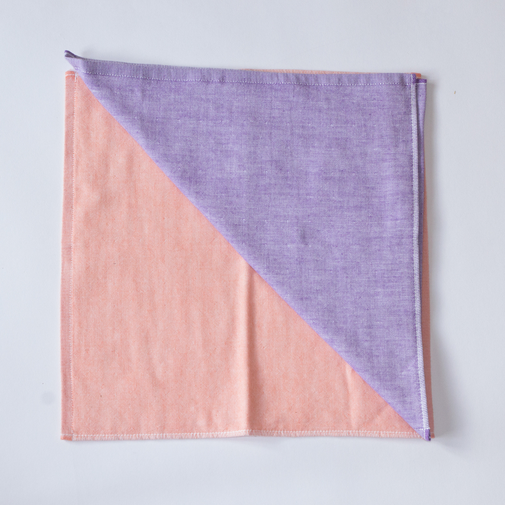 The Yoshii two-tone chambray towel in Orange 1 and Violet 2.